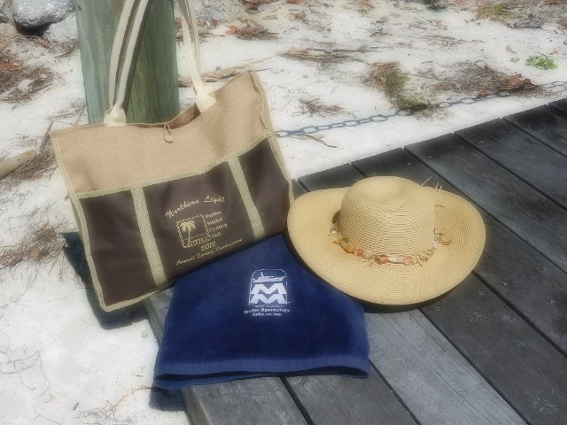 Hat and Bags on Beach